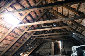 attic ceiling with exposed insulation.